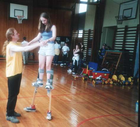 Tessa on stilts being assisted by Stevie Dalton
